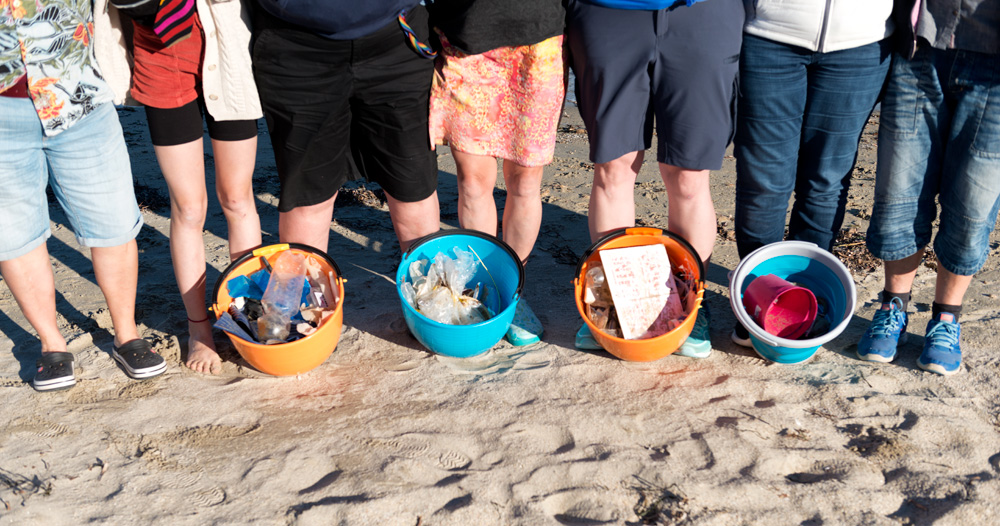 Greenpicks plastic waste collection helpers on the beach